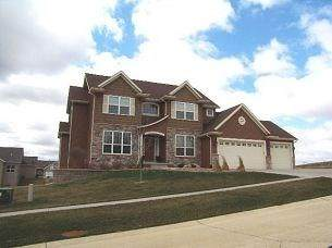 6809 Country Ridge Drive NW, Cedar Rapids, IA 52405 (MLS #2003908) :: The Graf Home Selling Team