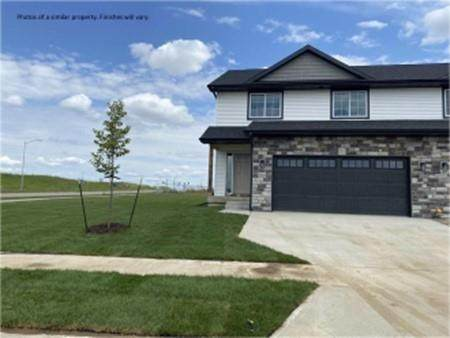 901 Creekside Drive, Tiffin, IA 52340 (MLS #2107111) :: The Graf Home Selling Team