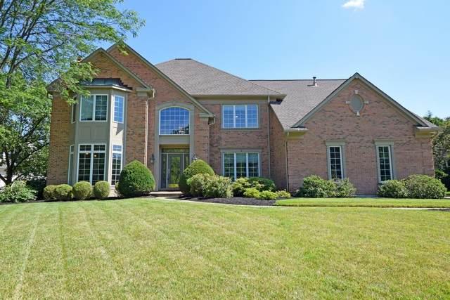 11042 Grandstone Lane, Montgomery, OH 45249 (#1706889) :: Century 21 Thacker & Associates, Inc.
