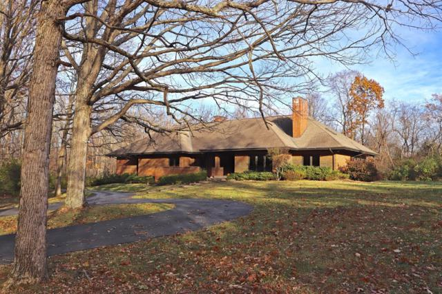 9180 Meadow Grove Lane, Indian Hill, OH 45243 (#1559615) :: The Dwell Well Group