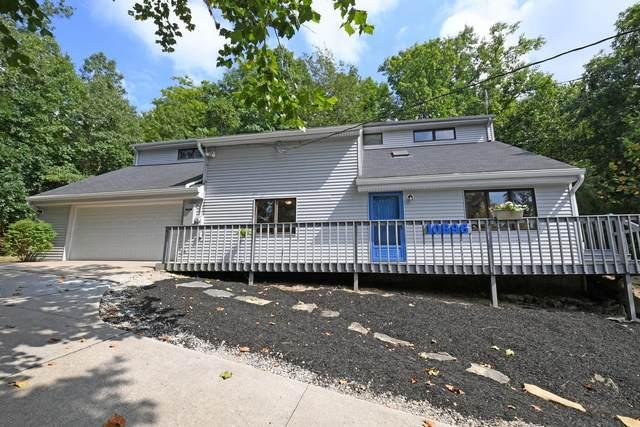 10596 New Biddinger Road, Harrison Twp, OH 45030 (#1673965) :: Century 21 Thacker & Associates, Inc.