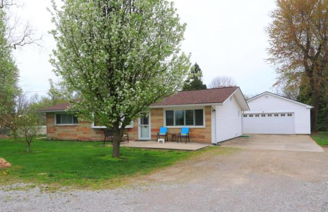 12131 Conrey Road, Sycamore Twp, OH 45249 (#1605873) :: Chase & Pamela of Coldwell Banker West Shell