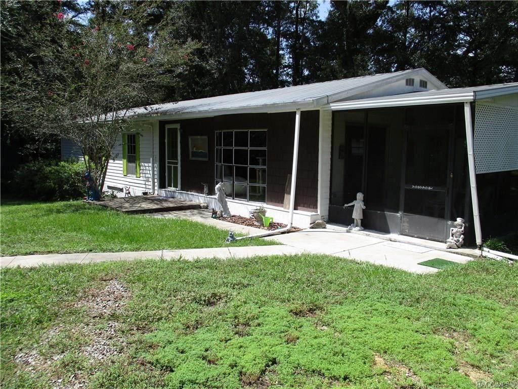 7700 Four Oaks Drive - Photo 1