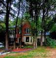 7923 Harrington Woods Road - Photo 1