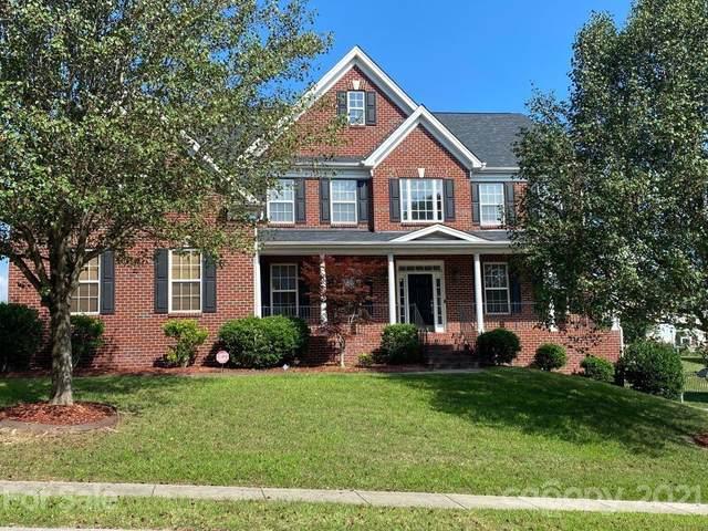 7960 Heatherstone Drive, Harrisburg, NC 28075 (#3759661) :: Willow Oak, REALTORS®