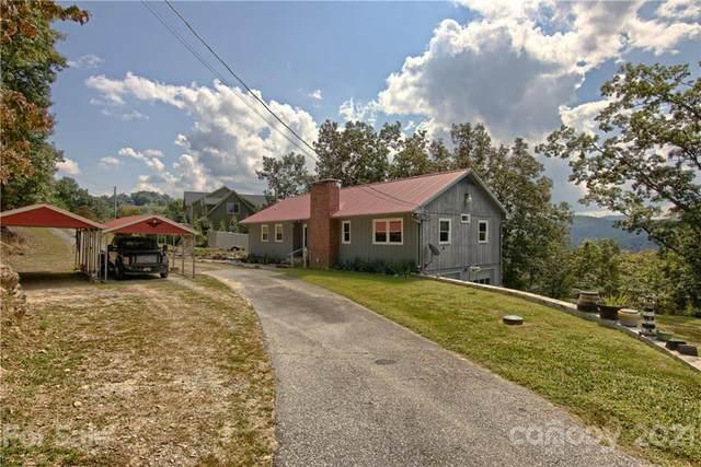 34 Hunters Trail, Hendersonville, NC 28739 (#3785573) :: The Ordan Reider Group at Allen Tate