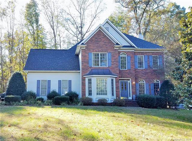 7920 Harrington Woods Road, Charlotte, NC 28269 (#3569646) :: The Ramsey Group