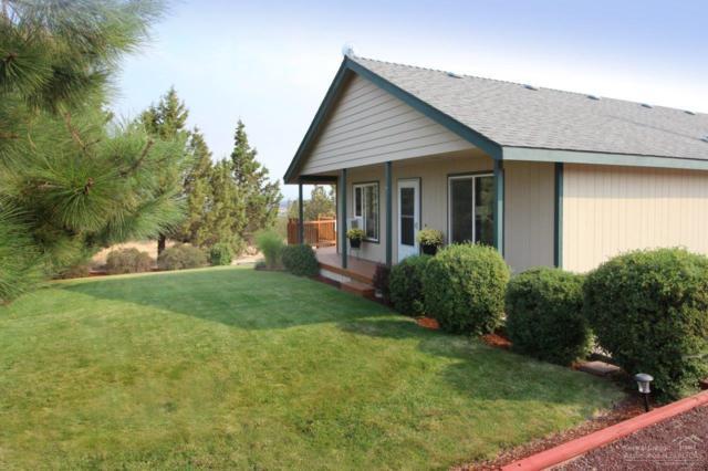 7742 SW Red Cloud Lane, Powell Butte, OR 97753 (MLS #201709454) :: Birtola Garmyn High Desert Realty