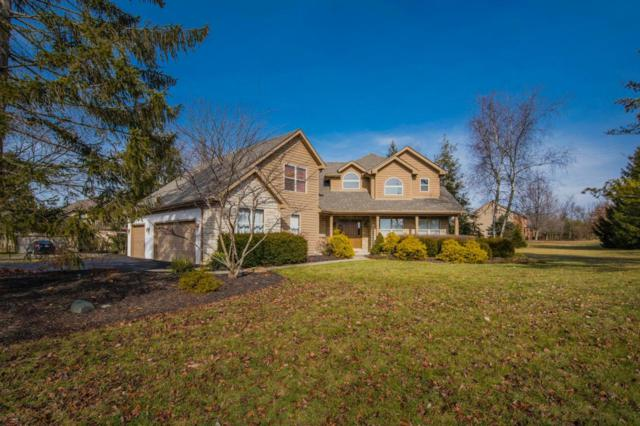 2222 Wyndbend Boulevard, Powell, OH 43065 (MLS #218002942) :: Berkshire Hathaway Home Services Crager Tobin Real Estate