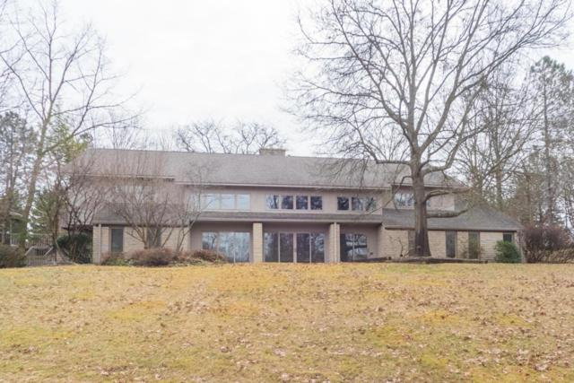4830 Oldbridge Drive, Columbus, OH 43220 (MLS #218003155) :: Berkshire Hathaway Home Services Crager Tobin Real Estate