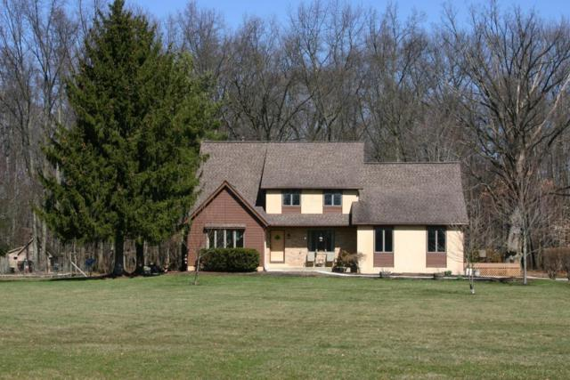 10051 Covan Drive, Westerville, OH 43082 (MLS #218006792) :: Berkshire Hathaway Home Services Crager Tobin Real Estate