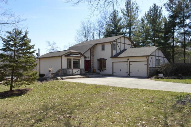 11450 Windridge Drive NW, Pickerington, OH 43147 (MLS #218007851) :: The Clark Group @ ERA Real Solutions Realty