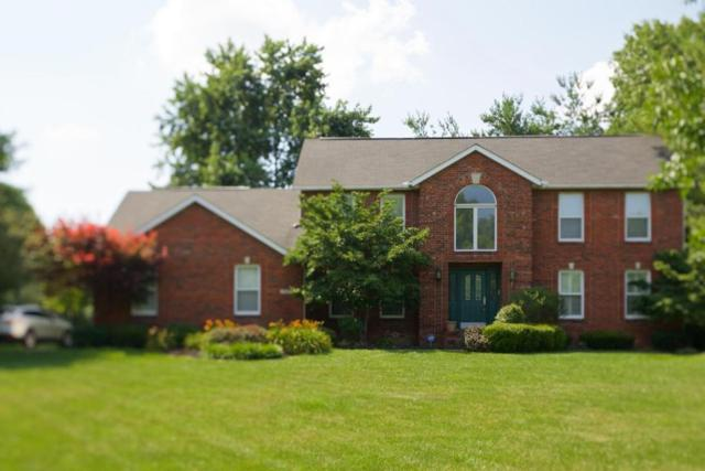 7627 Heatherwood Drive NW, Canal Winchester, OH 43110 (MLS #218024050) :: Berkshire Hathaway HomeServices Crager Tobin Real Estate