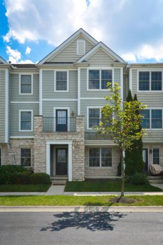 5911 Canyon Creek Drive #702, Dublin, OH 43016 (MLS #218033696) :: The Mike Laemmle Team Realty