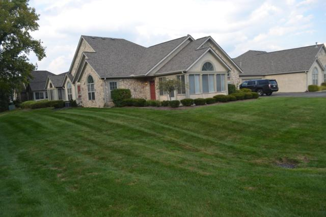 8576 Stonewoods Lane, Powell, OH 43065 (MLS #218035771) :: Shannon Grimm & Partners