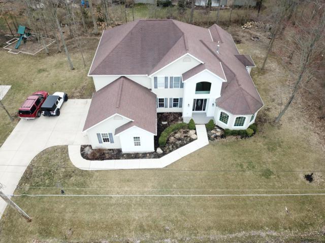 125 W Hiawatha Drive, Powell, OH 43065 (MLS #219008739) :: Shannon Grimm & Partners