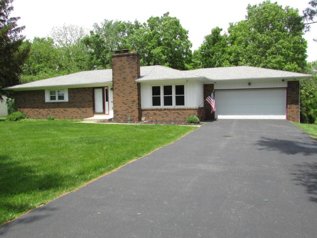5216 Brust Drive, Powell, OH 43065 (MLS #219017819) :: The Raines Group