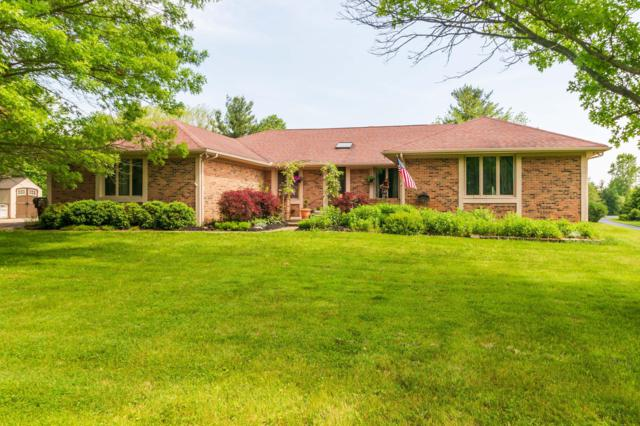 2080 Carriage Road, Powell, OH 43065 (MLS #219019030) :: The Clark Group @ ERA Real Solutions Realty