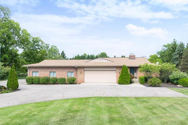 1660 W Powell Road, Powell, OH 43065 (MLS #219034554) :: The Raines Group