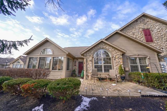 8720 Linksway Drive, Powell, OH 43065 (MLS #220004801) :: Core Ohio Realty Advisors