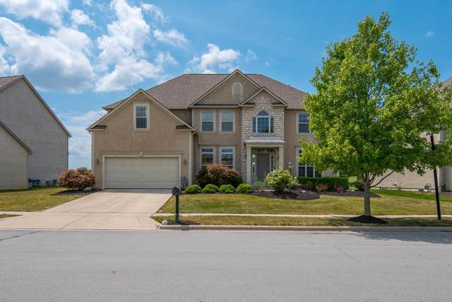 7704 Gateway Lane, Powell, OH 43065 (MLS #220024268) :: The Willcut Group