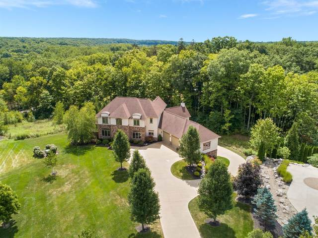 1409 Riverwood Lane, Powell, OH 43065 (MLS #220028812) :: The Jeff and Neal Team | Nth Degree Realty