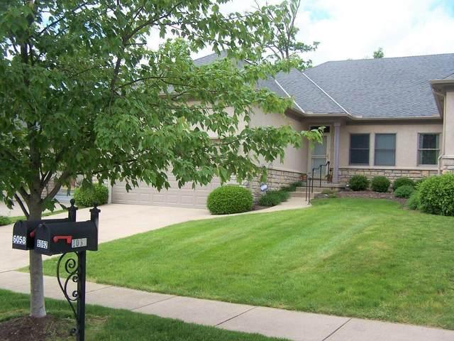 6058 Mcnaughten Grove Lane, Columbus, OH 43213 (MLS #221019275) :: Jamie Maze Real Estate Group