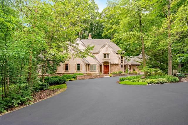 660 Woods Hollow Lane, Powell, OH 43065 (MLS #221020640) :: CARLETON REALTY