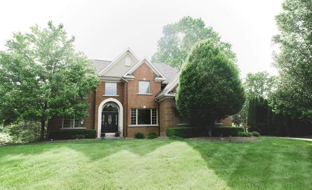 10884 Buckingham Place, Powell, OH 43065 (MLS #221021938) :: Greg & Desiree Goodrich | Brokered by Exp