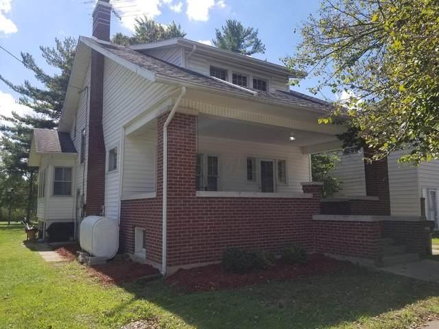 243 E Bennett Street, Woodstock, OH 43084 (MLS #221035855) :: Jamie Maze Real Estate Group