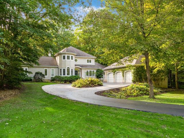 640 Woods Hollow Lane, Powell, OH 43065 (MLS #221039119) :: Signature Real Estate