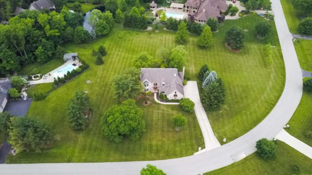 411 Cardinal Hill Lane, Powell, OH 43065 (MLS #218019359) :: Berkshire Hathaway HomeServices Crager Tobin Real Estate