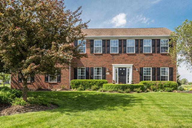 7833 Polo Lane, Powell, OH 43065 (MLS #219016669) :: Huston Home Team
