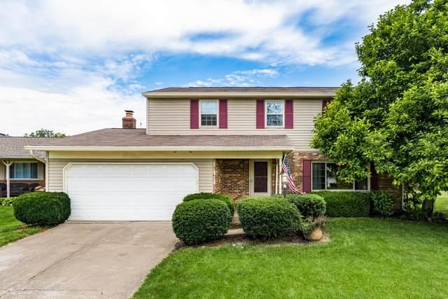 2036 Queensbridge Drive, Columbus, OH 43235 (MLS #221022054) :: Jamie Maze Real Estate Group