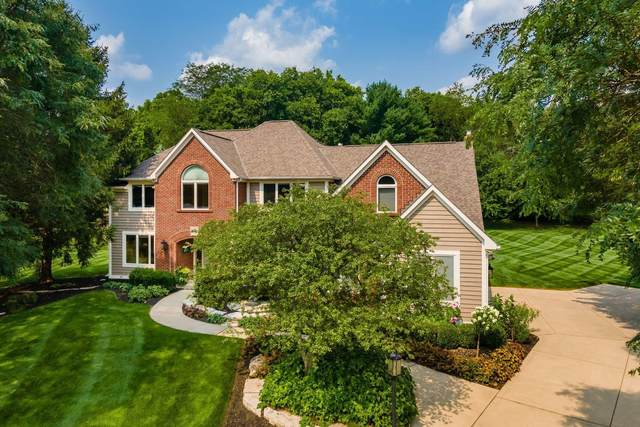 10809 Buckingham Place, Powell, OH 43065 (MLS #221028957) :: The Raines Group