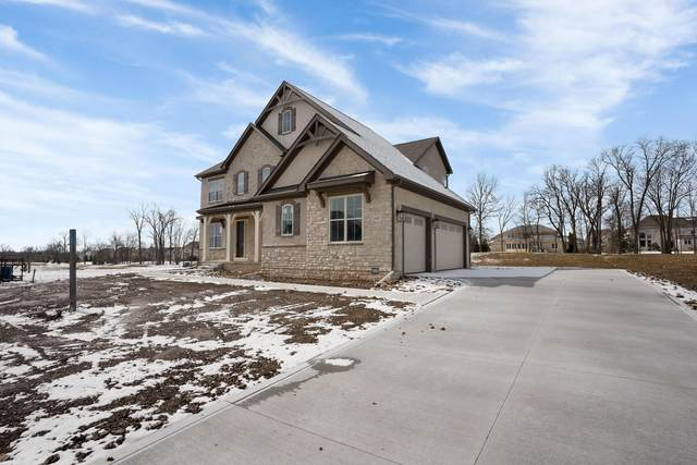 9441 Waterford Drive, Powell, OH 43065 (MLS #219027113) :: Susanne Casey & Associates
