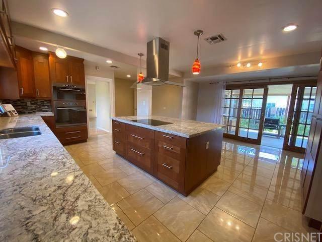 7755 Genesta Avenue, Lake Balboa, CA 91406 (#SR20107470) :: SG Associates