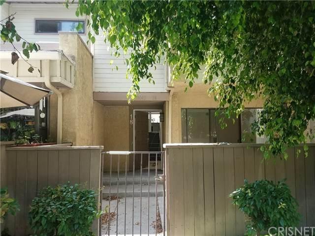10045 Topanga Canyon Boulevard #18, Chatsworth, CA 91311 (#SR20124200) :: Randy Plaice and Associates