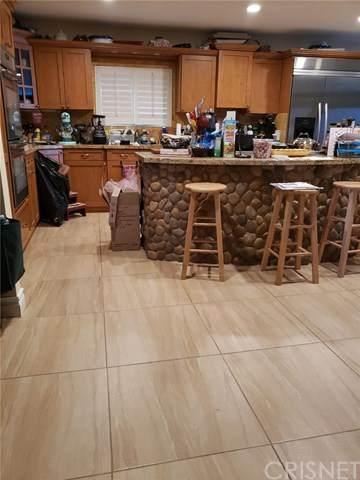 21627 Mulholland Drive, Woodland Hills, CA 91364 (#SR20131471) :: Randy Plaice and Associates