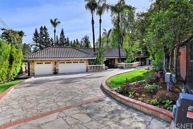 4650 Caritina Drive, Tarzana, CA 91356 (#SR21023841) :: The Grillo Group