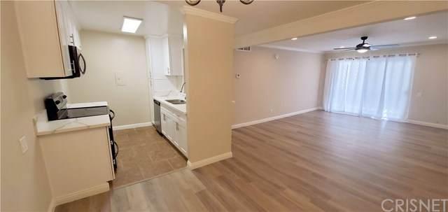 5460 White Oak Avenue B105, Encino, CA 91316 (#SR21044294) :: TruLine Realty