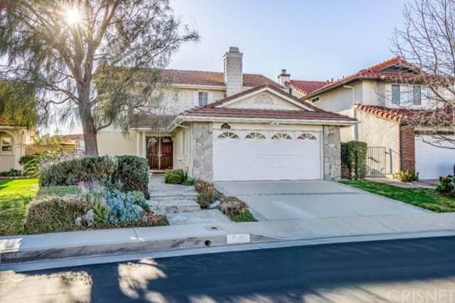 12101 Crystal Glen Way, Porter Ranch, CA 91326 (#SR21045525) :: The Grillo Group