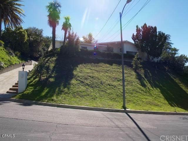 5933 Mcdonie Avenue, Woodland Hills, CA 91367 (#V1-4286) :: The Suarez Team