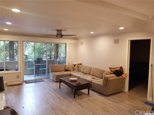 7800 Topanga Canyon Boulevard #201, Canoga Park, CA 91304 (#320005785) :: Lydia Gable Realty Group