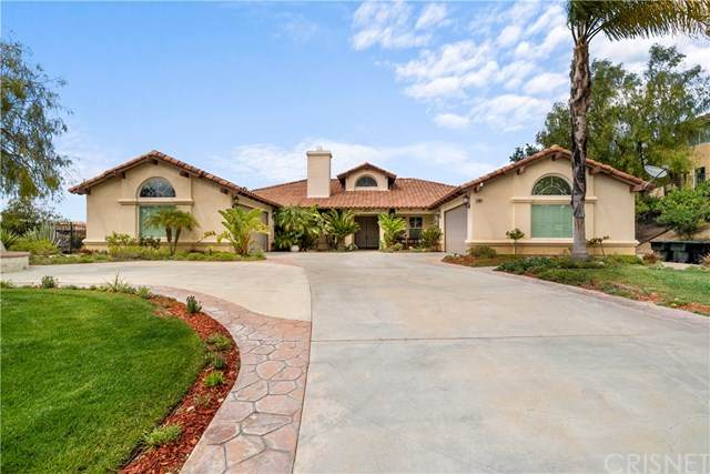 23091 Lowridge Place, Saugus, CA 91390 (#SR21091630) :: Montemayor & Associates