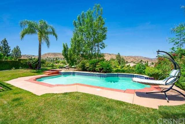 7441 Rutherford Hill Drive, West Hills, CA 91307 (#SR21131066) :: Angelo Fierro Group   Compass