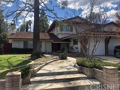 19122 Los Alimos Street, Porter Ranch, CA 91326 (#SR21128016) :: The Grillo Group