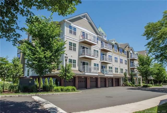 34 Schoolhouse Drive #101, West Hartford, CT 06110 (MLS #170360047) :: Around Town Real Estate Team