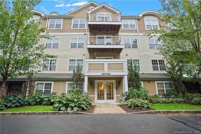 26 Schoolhouse Drive #407, West Hartford, CT 06110 (MLS #170440515) :: Carbutti & Co Realtors