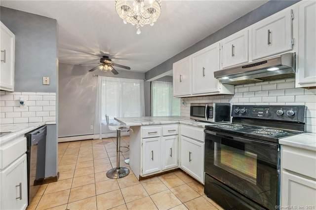 62 Woodland Drive #62, Cromwell, CT 06416 (MLS #170435994) :: Carbutti & Co Realtors